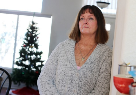 woman looking worried about medical bills