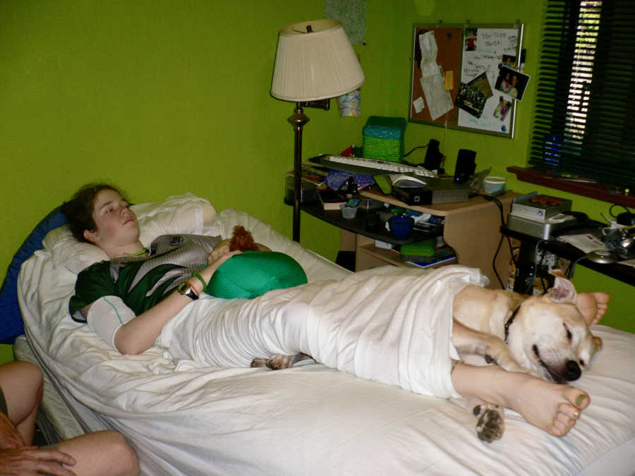 rachel and dog in bed